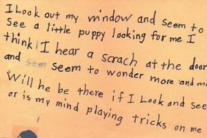 handwritten second grade poem in black ink on orange construction paper
